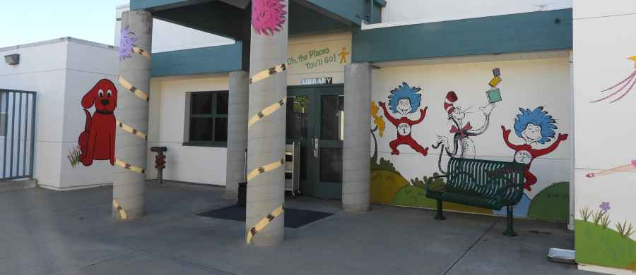 Photo showing characters painted on the outside of the school library.